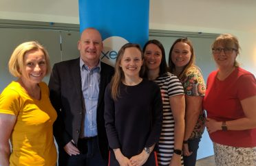 Team photo in front of Xero banner at a venue just off the Yeovil - Taunton link road - we're a Xero Accountant in South Devon, Somerset and beyond and provide accountancy services packages