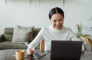 Woman working at home and making a video call on a laptop